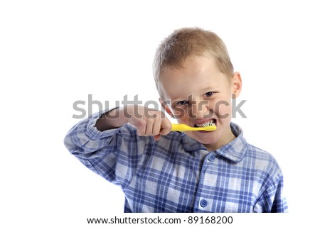 little boy cleaning his teeth. isolated on white background