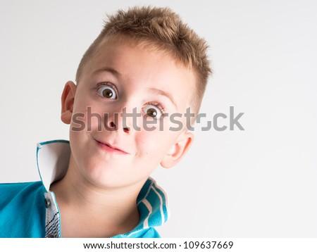 Little Boy Close Up isolated on white background - stock photo