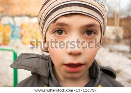 little boy close up surprised portrait on the street - stock photo
