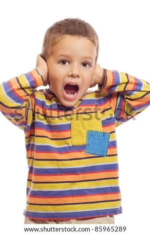 Little boy closing ears with his hands, isolated on white - stock photo