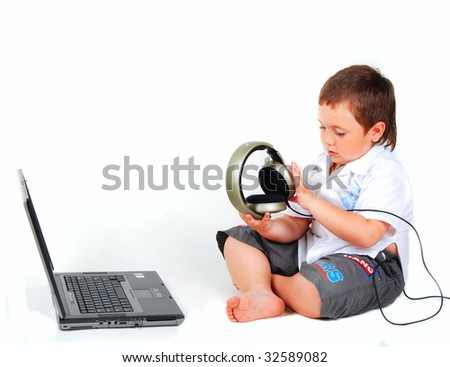 little boy, computer, headphones on a white background