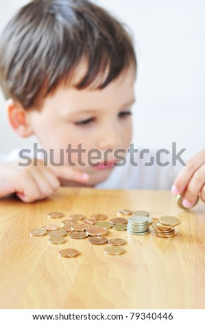 Little boy counting money - stock photo