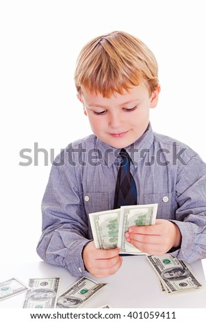 Little boy counting one hundred american dollar bills