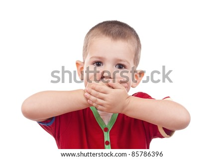Little boy covering her mouth with her hand - stock photo