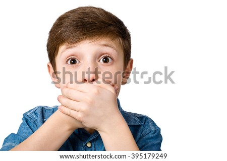 Little boy covering her mouth with her hands. Surprised or scared. On white background. - stock photo
