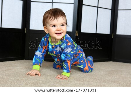 Little boy crawling on the floor - stock photo