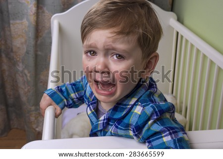 little boy crying hysterically - stock photo