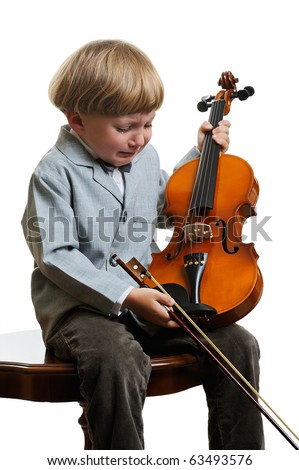 little boy crying in the violin lesson - stock photo