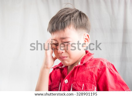 Little boy crying with sadness - stock photo