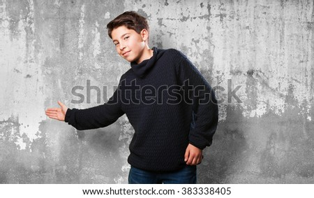 little boy doing a welcome gesture - stock photo
