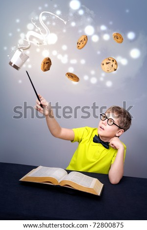 Little boy doing magic - stock photo
