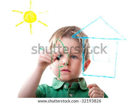 Little boy drawing on glass. Isolated on white. - stock photo