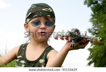 little boy dreams of becoming a fighter pilot - stock photo