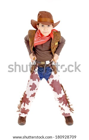 little boy dressed as a cowboy isolated in white - stock photo