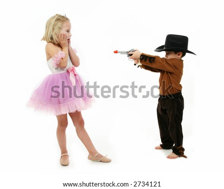 Little boy dressed as a deputy and girl in ballerina costume role-playing - stock photo