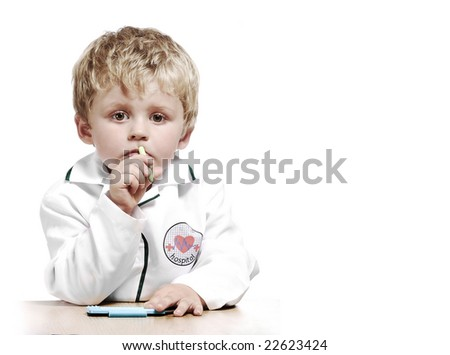 Little boy dressed as a doctor with a serious expression - stock photo
