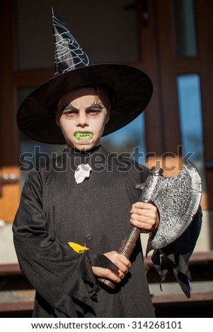 little boy dressed as an executioner at the holliday halloween - stock photo