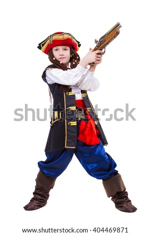 Little boy dressed as pirate holding a gun. Isolated on white - stock photo