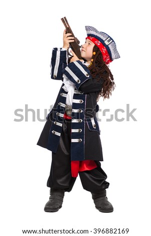 Little boy dressed as the medieval pirate holding a gun. Isolated on white - stock photo