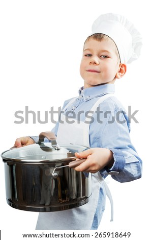 Little boy dressed like a chef making diner