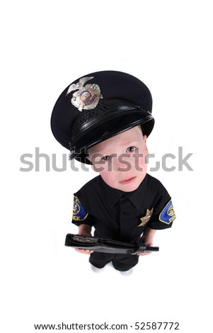 Little Boy Dressed up as a Police Officer Top View Fisheye - stock photo
