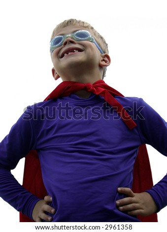 Little boy dressed up as a superhero on isolated background