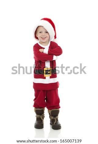 Little boy dressed up in Santa costume - stock photo