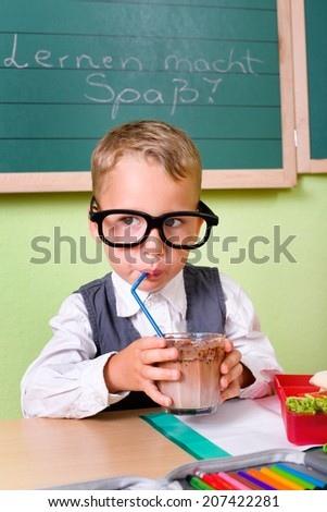 little boy drinking a cocoa - stock photo