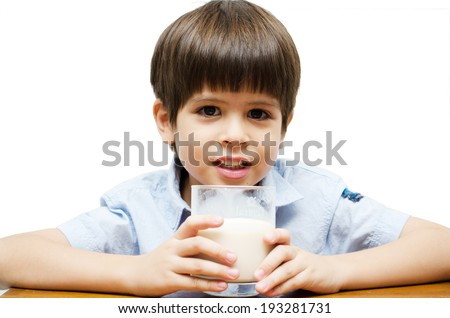 Little boy drinking milk with smiling  - stock photo