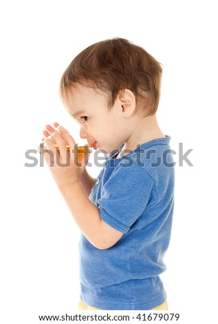 Little boy drinks apple juice from glass isolated on white
