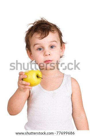 Little boy eating an apple. Isolated on white - stock photo
