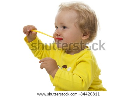 Little boy eating breakfast isolated on white. - stock photo