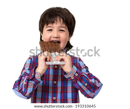 Little boy eating chocolate isolated on white - stock photo