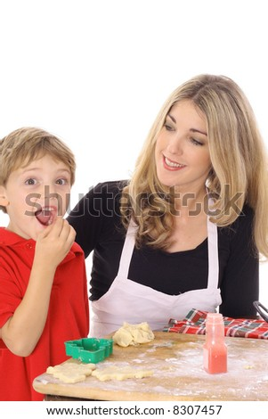little boy eating cookie batter