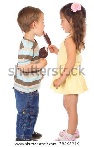 Little boy eating girl's chocolate ice cream - stock photo