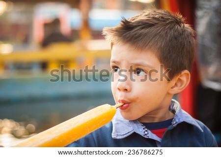 Little boy eating his ice cream  ice-lolly. - stock photo