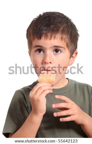 Little boy eating ice cream orange a over white background - stock photo