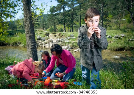 Little boy eating last cookie - stock photo