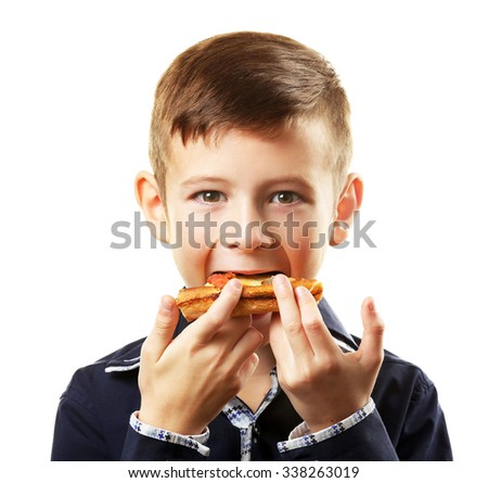 Little boy eating pizza isolated on white - stock photo