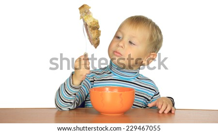 little boy eats with a fork - stock photo