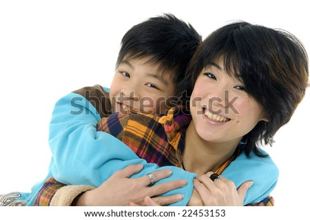 little boy embracing his beautiful young mother