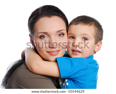little boy embracing his pretty young mother