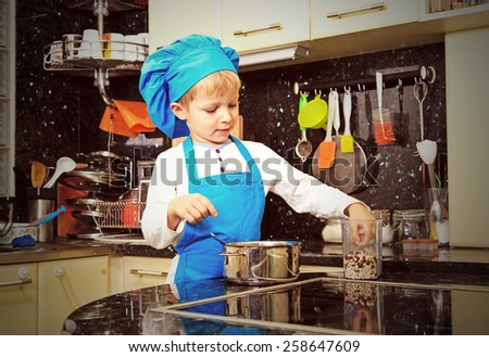 little boy enjoy cooking in kitchen interior
