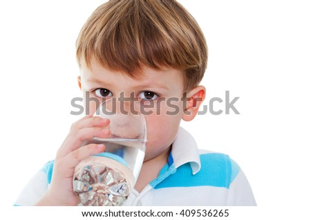 Little boy enjoying a glass of water, isolated on a white background