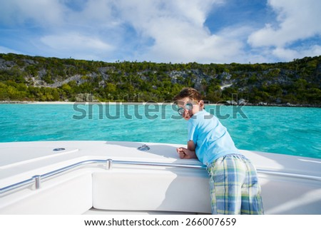 Little boy enjoying vacation on a luxury yacht or private tour boat - stock photo