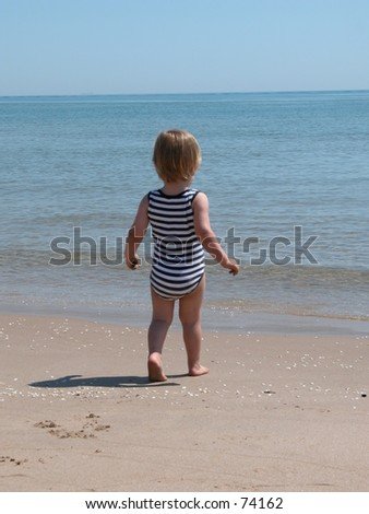 Little boy entering the sea.