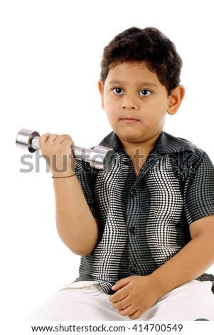 Little boy exercise with dumbbells against white background