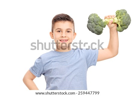 Little boy exercising with a broccoli dumbbell isolated on white background - stock photo