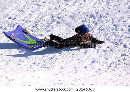 Little Boy Falling While Sledding down the Hill - Winter Scenes