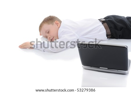 little boy fell asleep in front of a laptop. Isolated on white background - stock photo